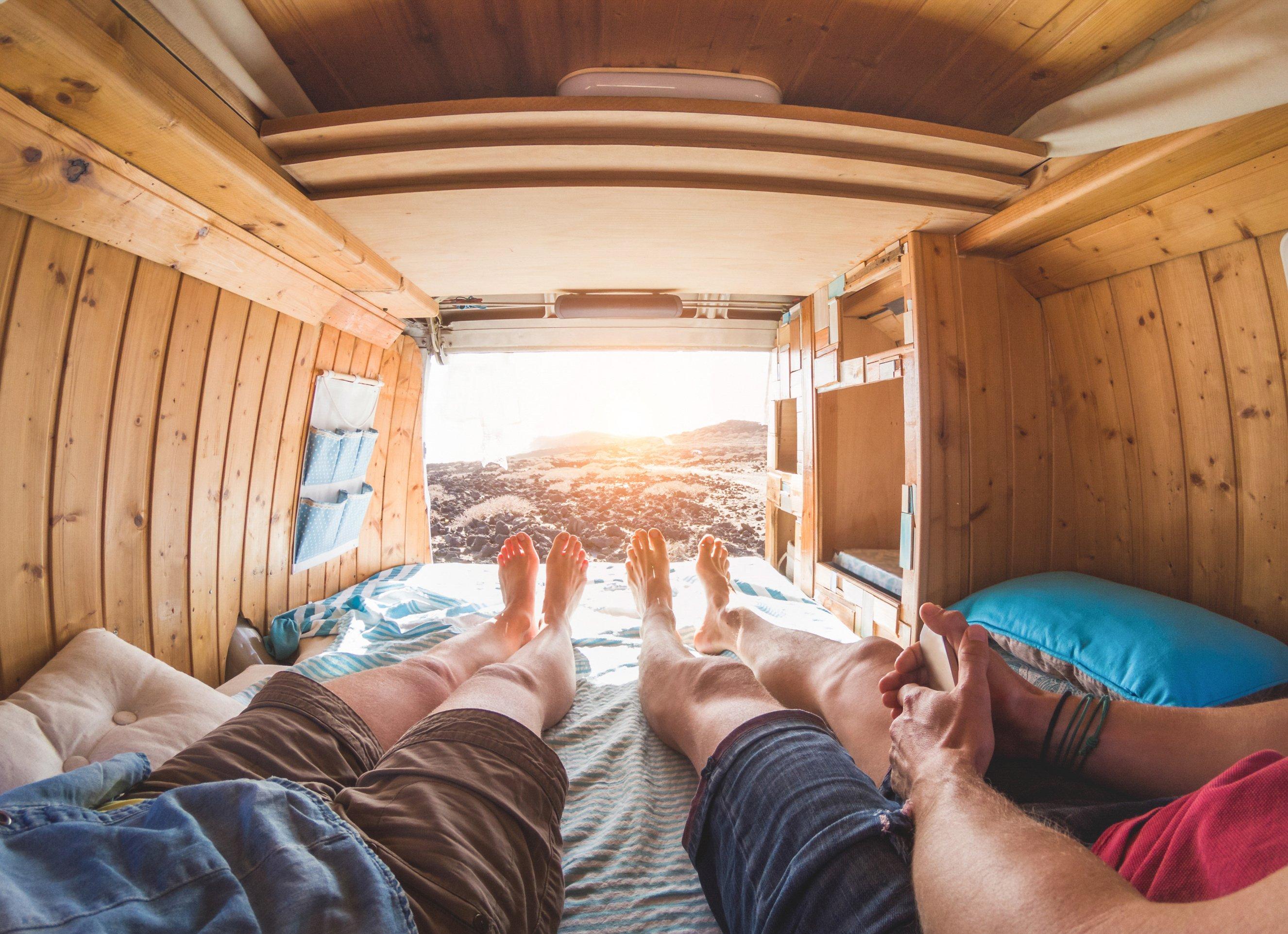couple inside reclaimed wood minivan with custom wood molding in Columbus, Gem Village